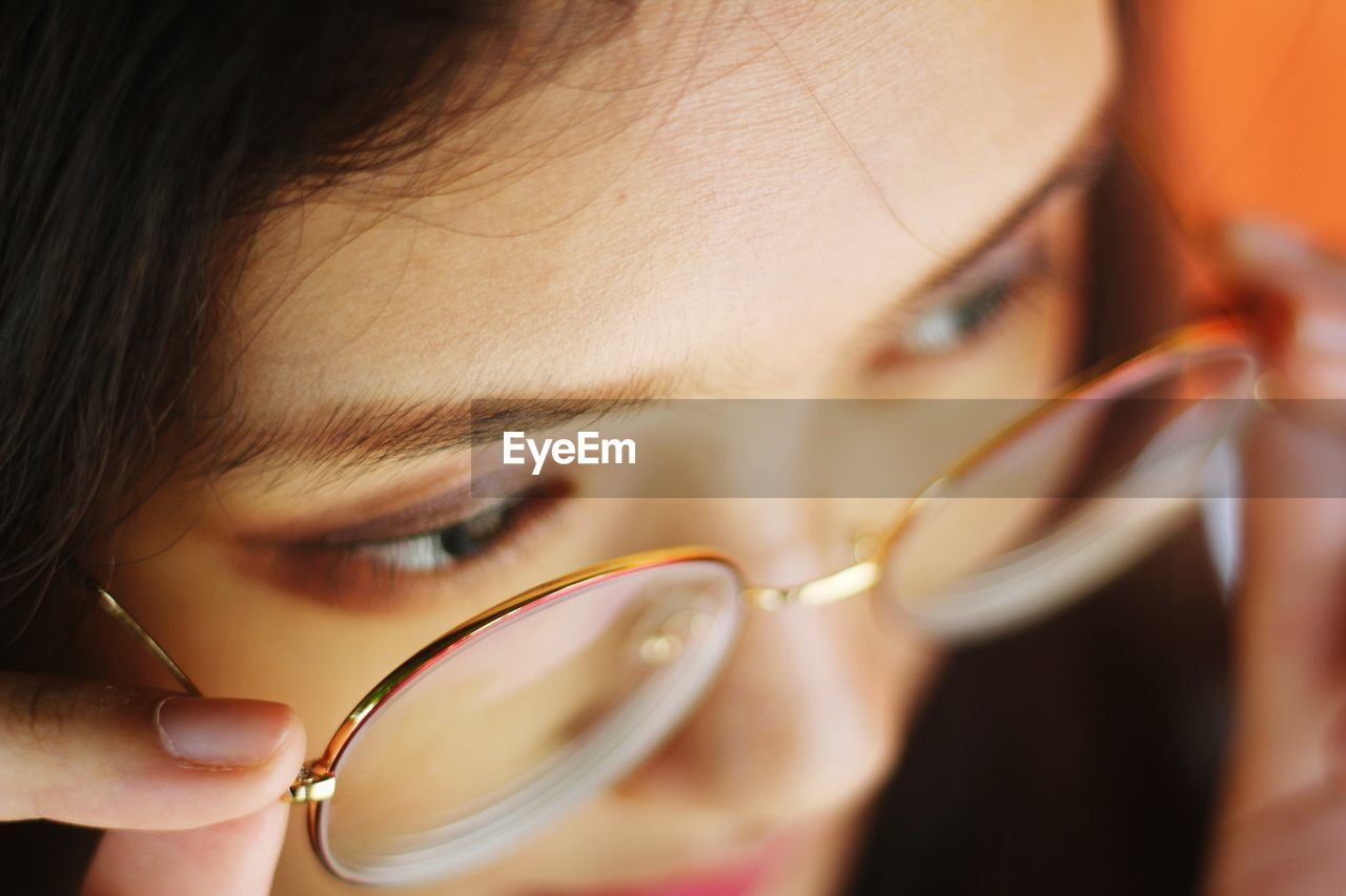 Close-up of woman wearing eyeglasses