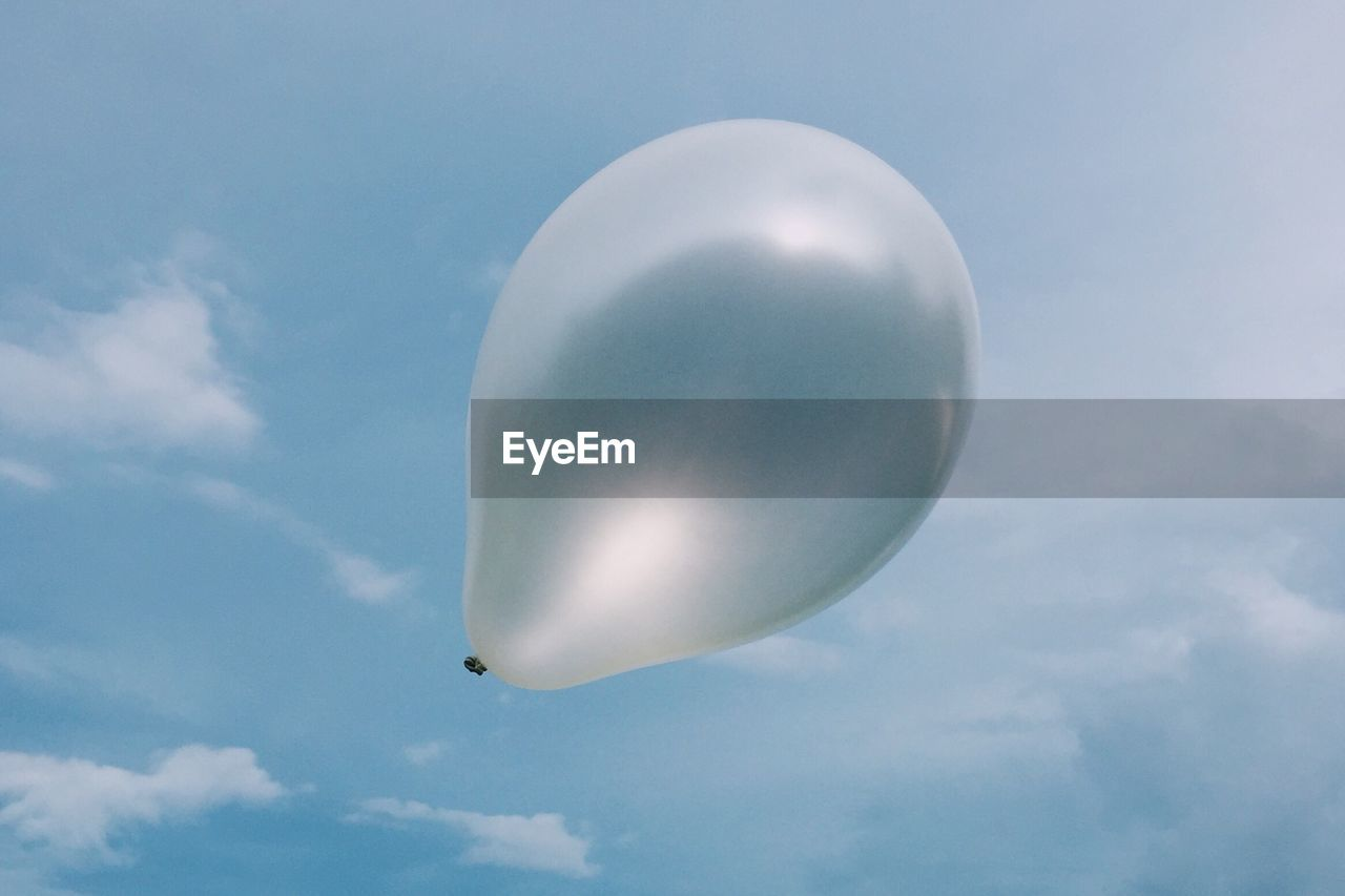 Low Angle View Of Silver Balloon Against Sky