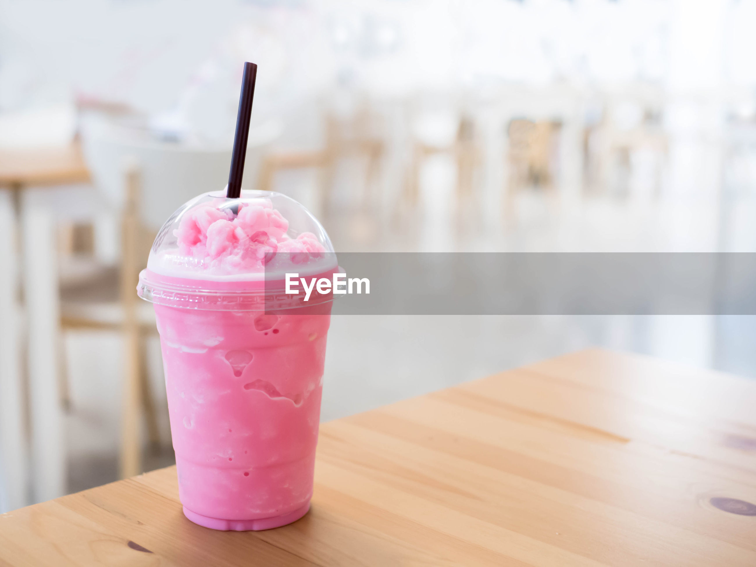 Close-up of smoothie on wooden table