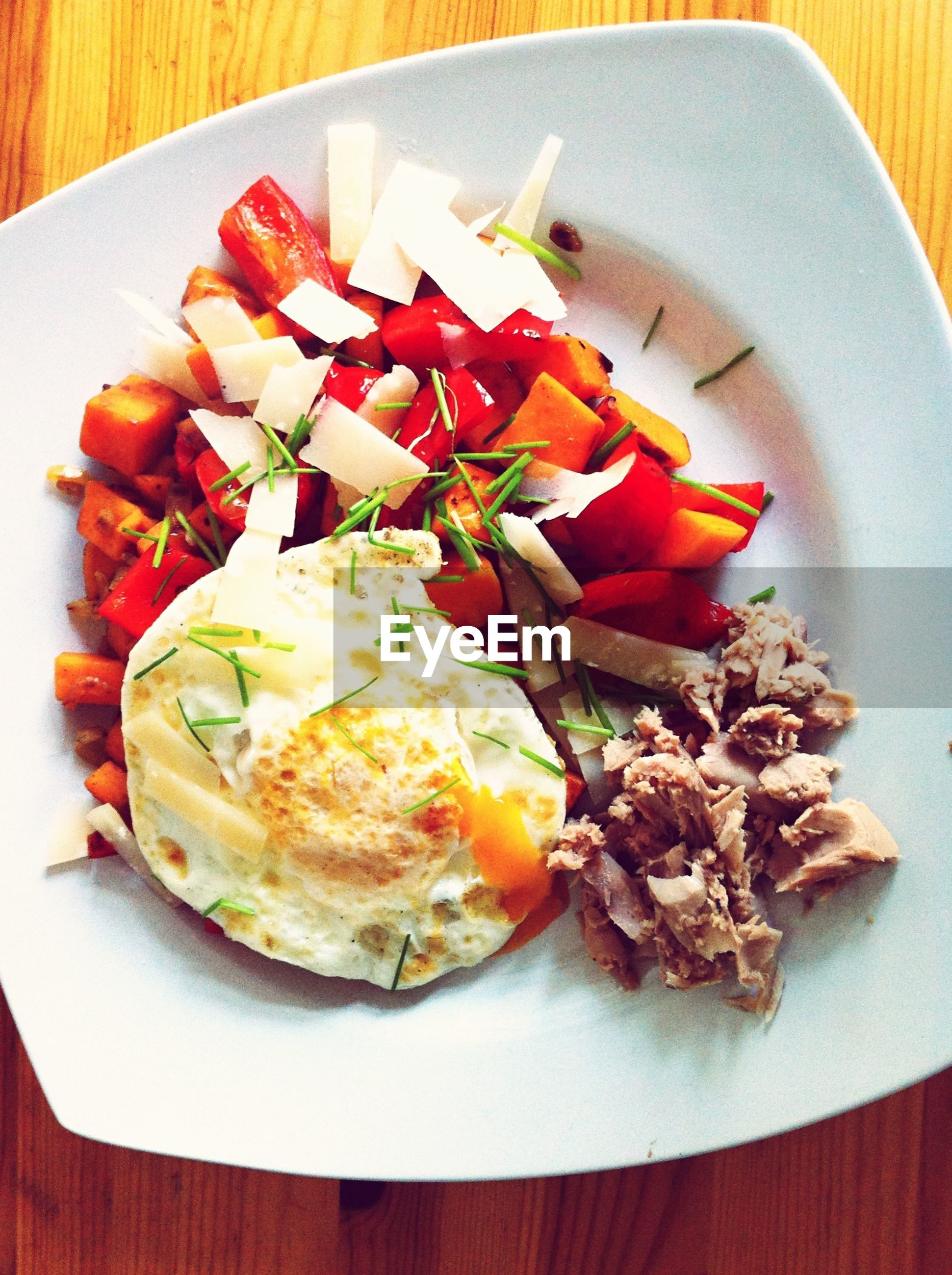 Fried egg with vegetables on plate