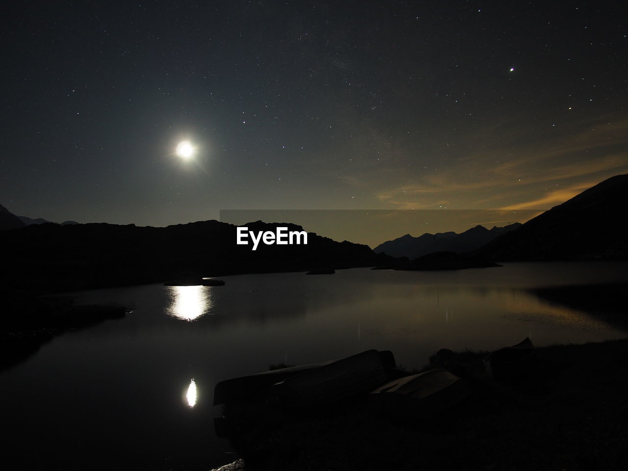 sky, water, night, scenics - nature, beauty in nature, tranquility, tranquil scene, moon, lake, reflection, nature, mountain, no people, astronomy, space, moonlight, idyllic, star - space, silhouette, full moon, outdoors, planetary moon