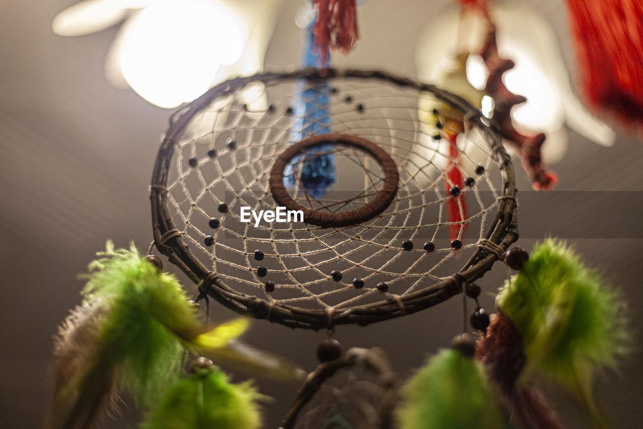 LOW ANGLE VIEW OF ILLUMINATED LIGHTING EQUIPMENT HANGING ON METAL