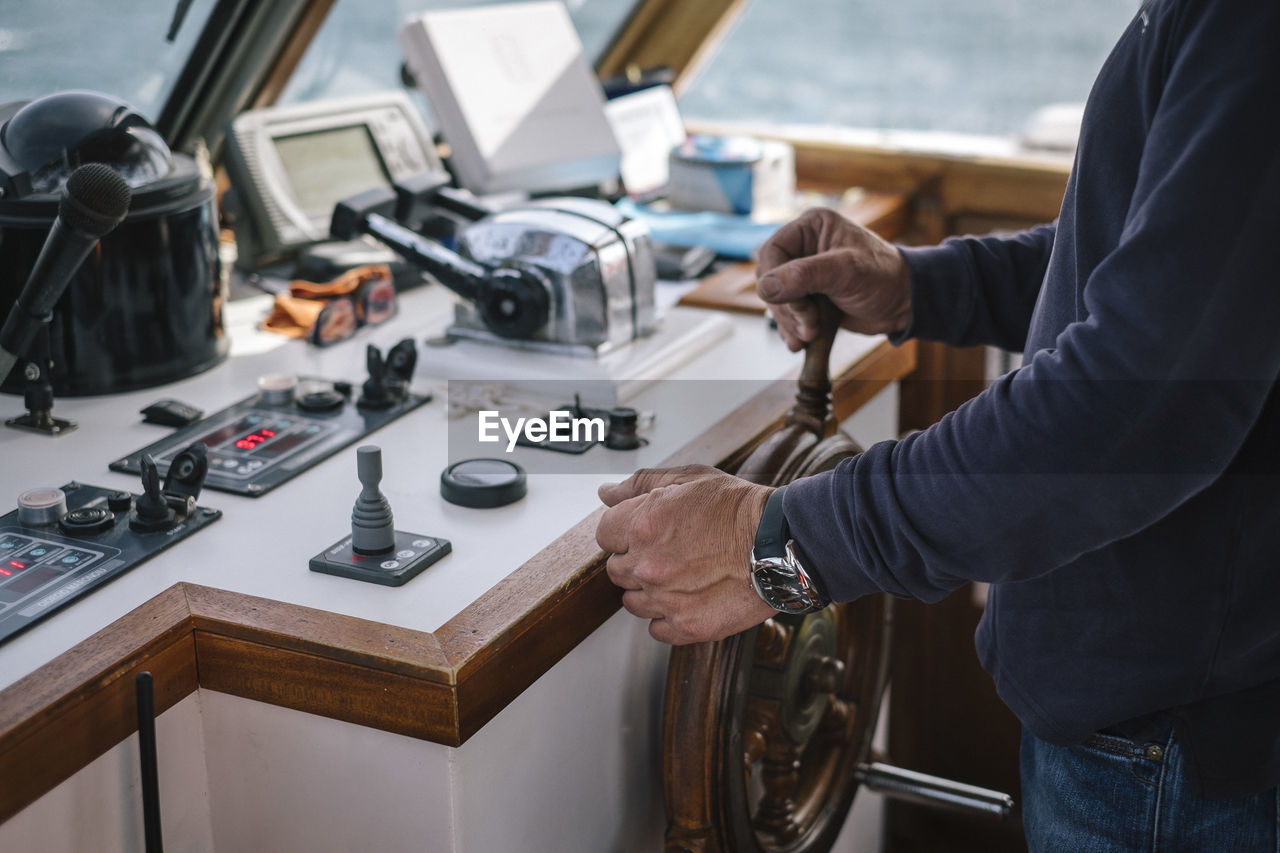 Midsection Of Boat Captain In Ship
