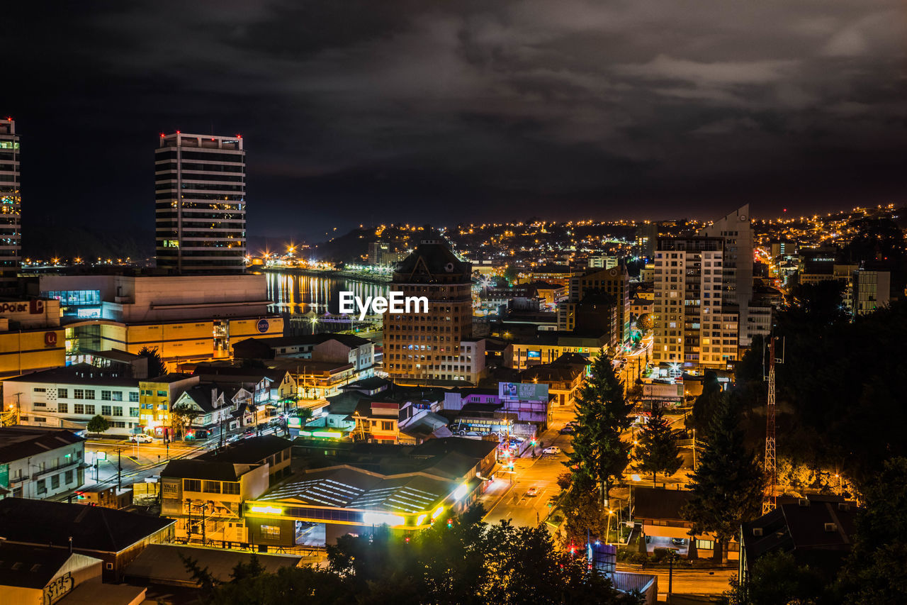 building exterior, architecture, city, built structure, cloud - sky, illuminated, building, sky, cityscape, night, residential district, crowded, high angle view, crowd, nature, storm, outdoors, dusk, modern, office building exterior, skyscraper, ominous, settlement