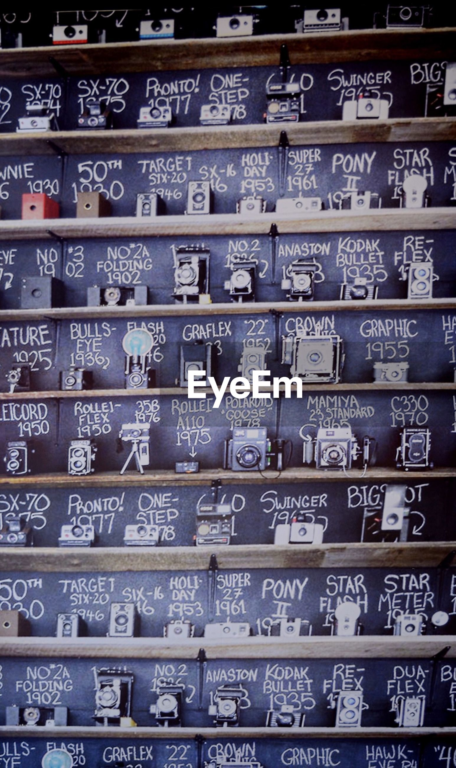 Various cameras arranged in shelf