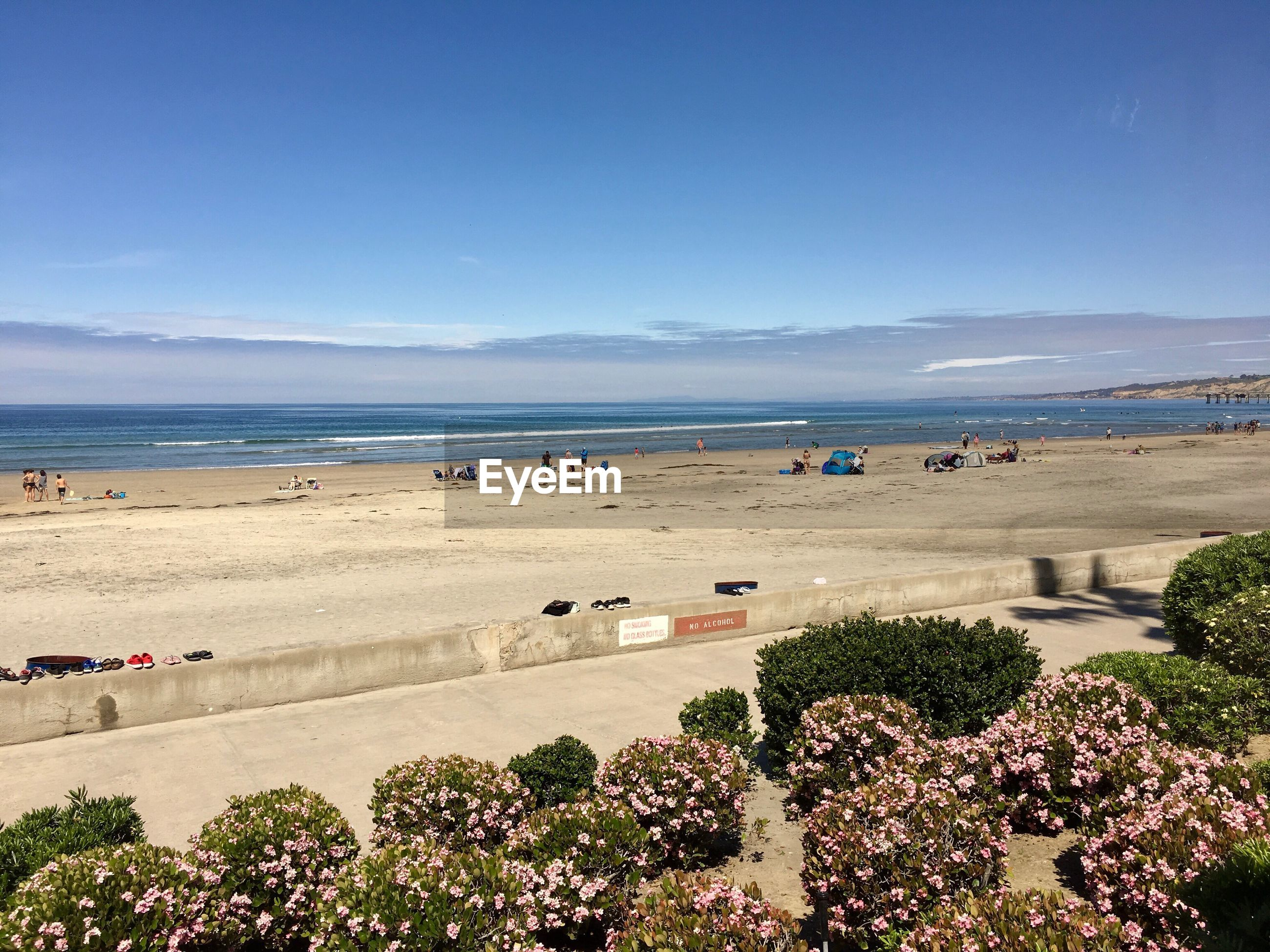 High angle view of people at beach against blue sky during sunny day