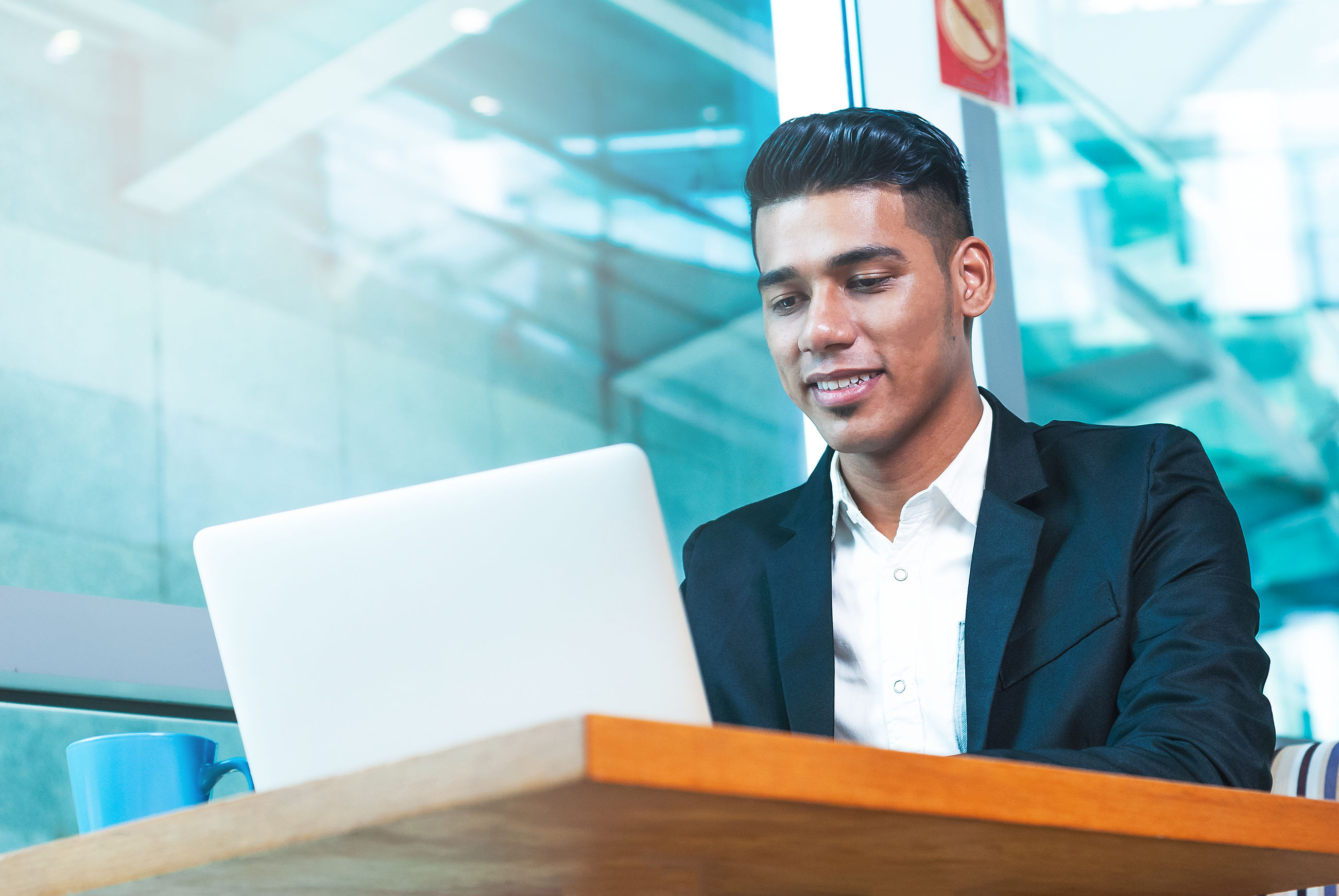 Businessman using laptop on table