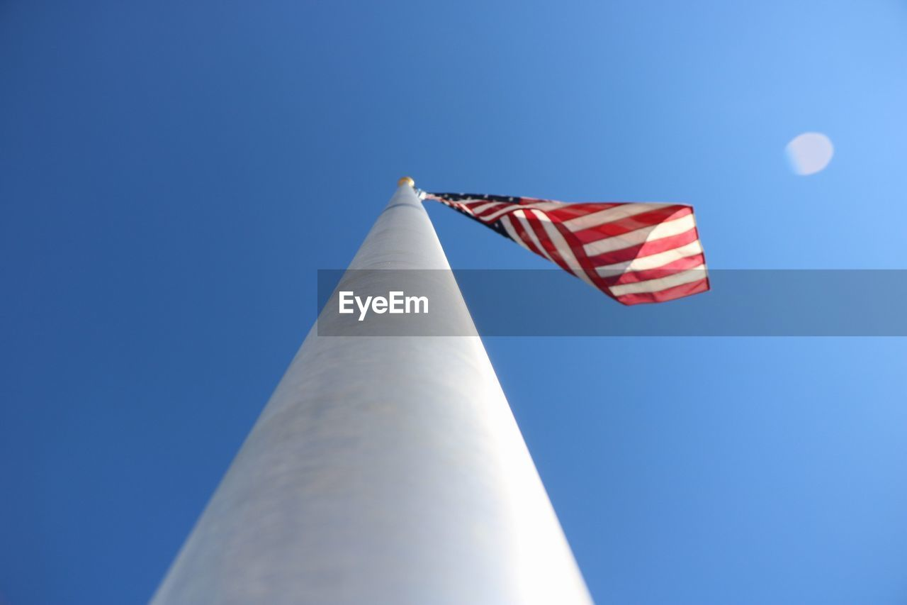 low angle view, patriotism, flag, clear sky, blue, striped, no people, outdoors, day, stars and stripes, sky, nature