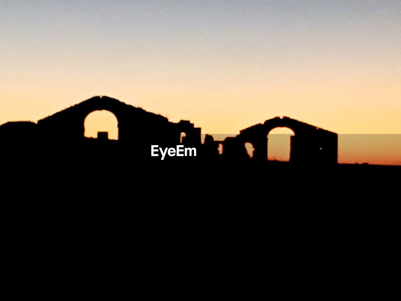 silhouette, sunset, built structure, architecture, history, no people, clear sky, outdoors, building exterior, sky, travel destinations, nature, ancient civilization, day