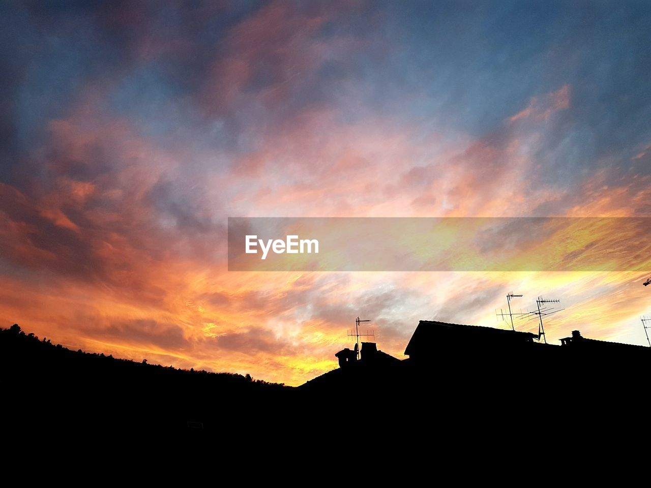 sunset, silhouette, architecture, building exterior, built structure, low angle view, sky, outdoors, no people, nature, wireless technology, beauty in nature, day