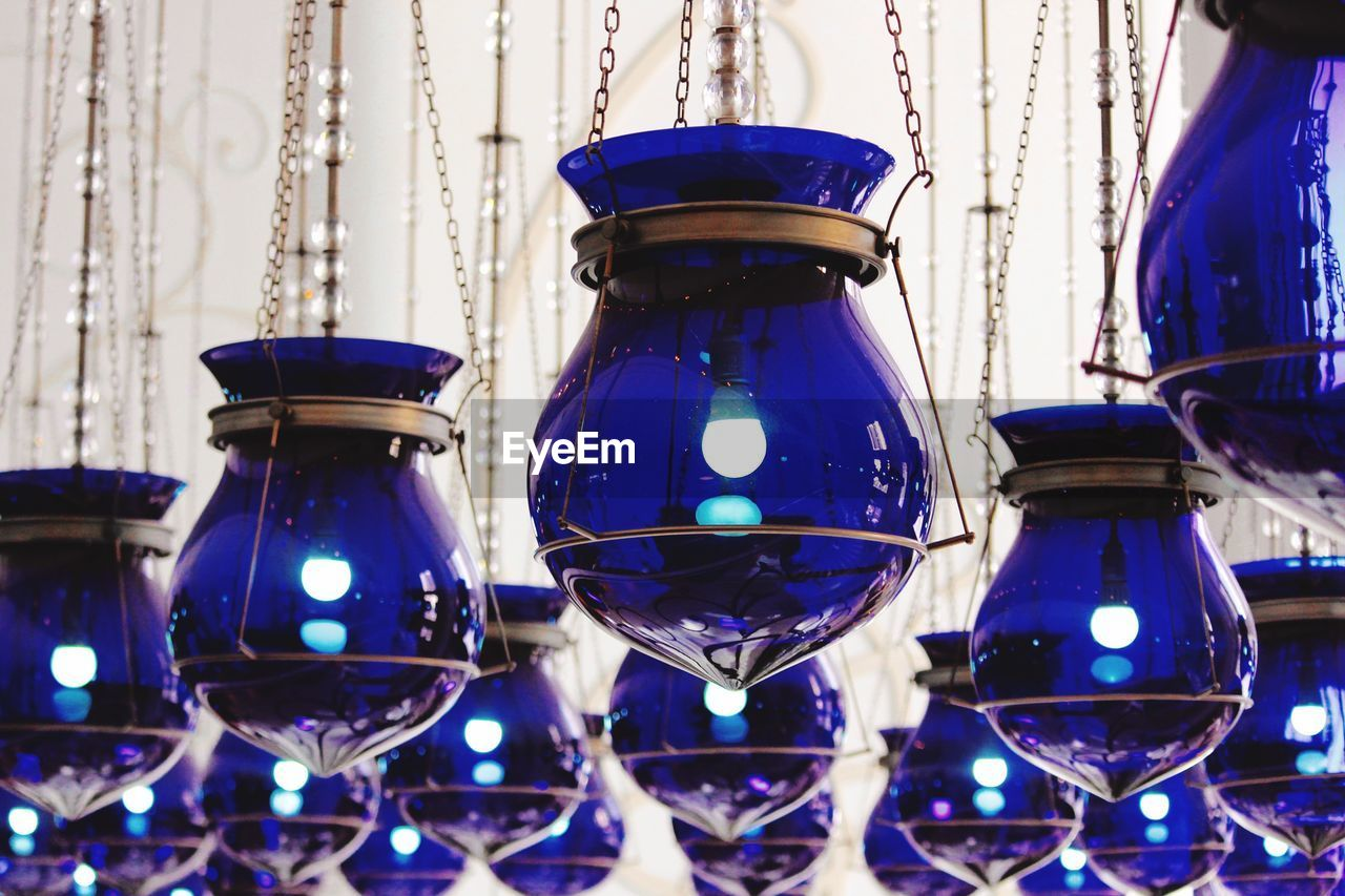 Illuminated Blue Lanterns Hanging From Ceiling