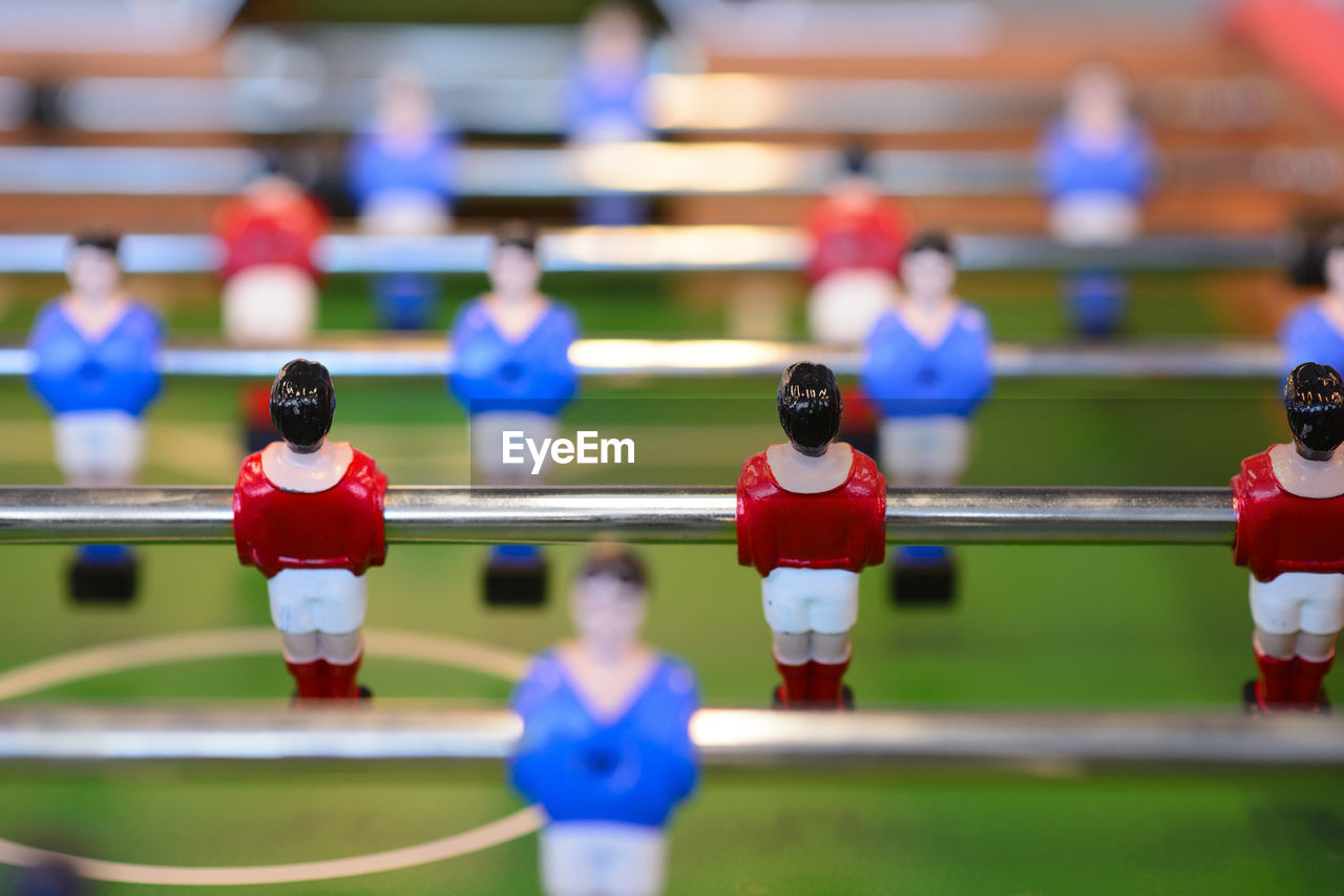 sport, competition, team sport, soccer, figurine, competitive sport, teamwork, cooperation, focus on foreground, leisure games, human representation, sports team, sports uniform, people, relaxation, representation, male likeness, playing, leisure activity, group of people