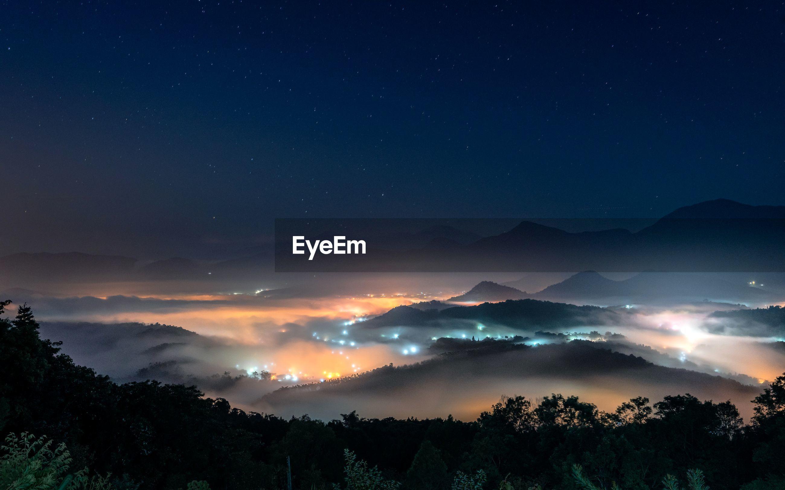 Scenic view of sea of clouds on jinlong mountain at night, taichung taiwan