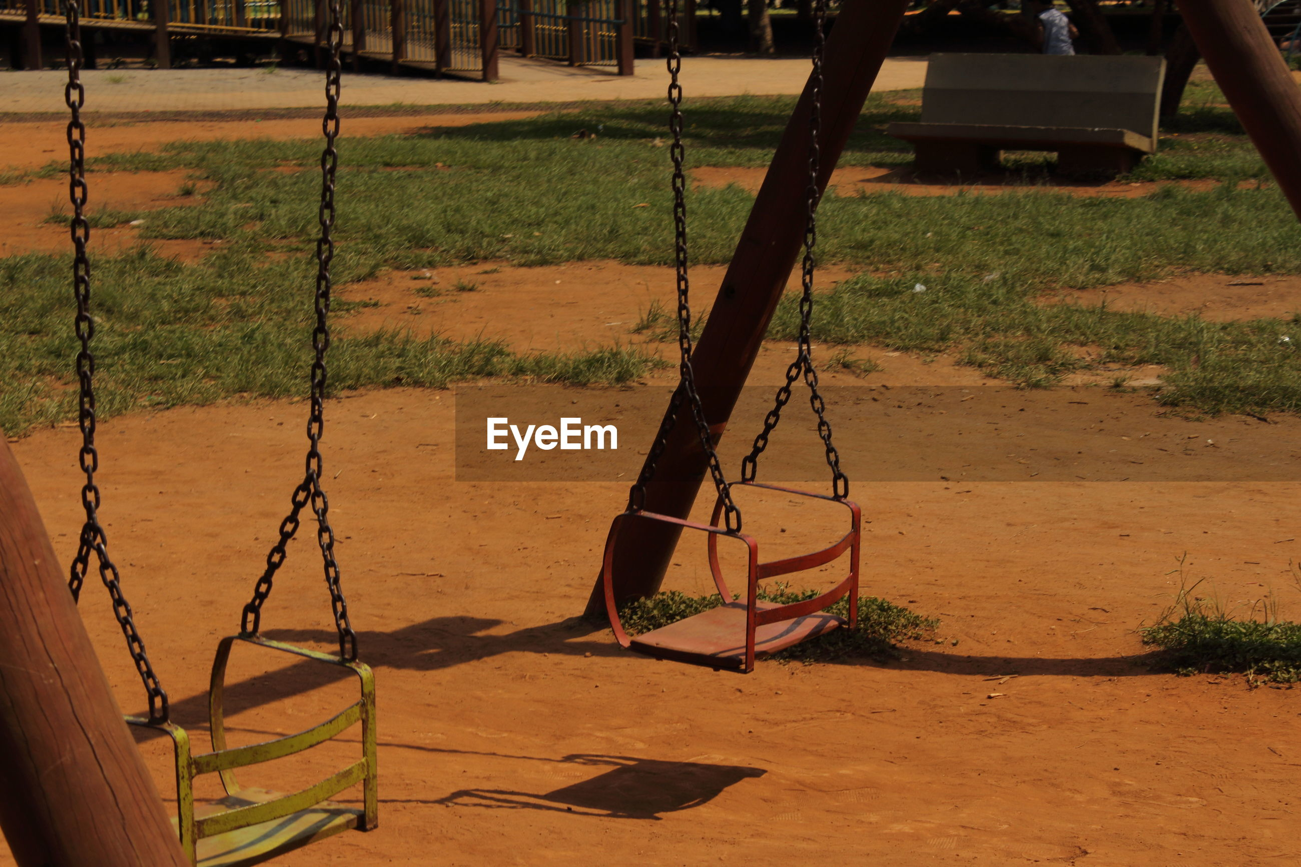 swing, playground, outdoor play equipment, hanging, outdoors, rope swing, sand, no people, day, childhood, grass, nature