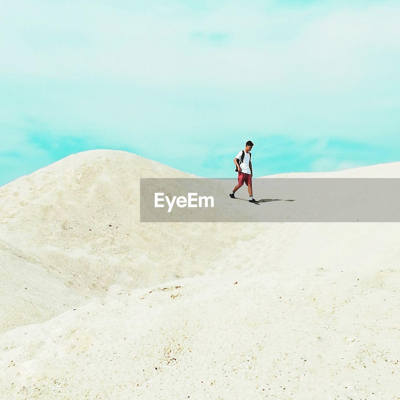 Man Walking At Desert