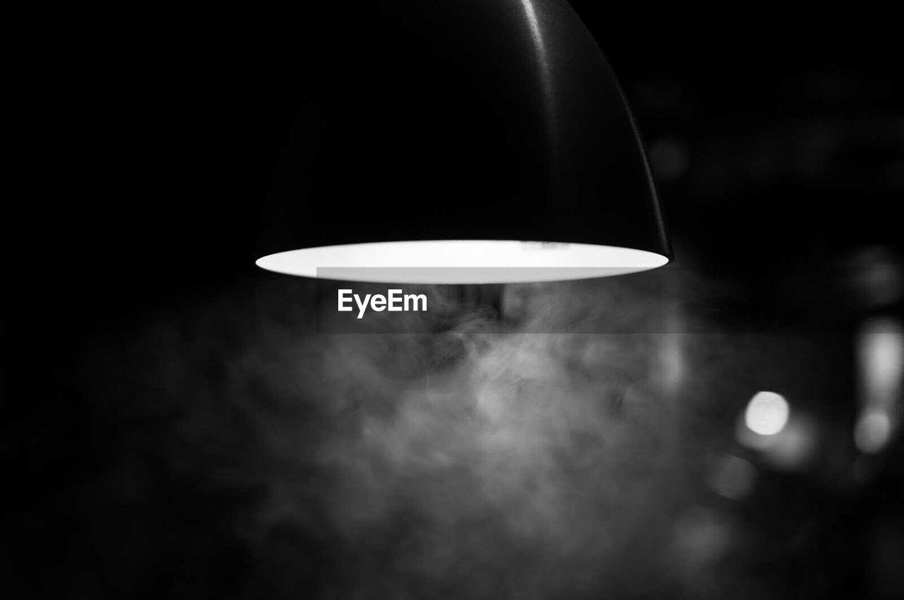 Close-up of fog under illuminated lamp