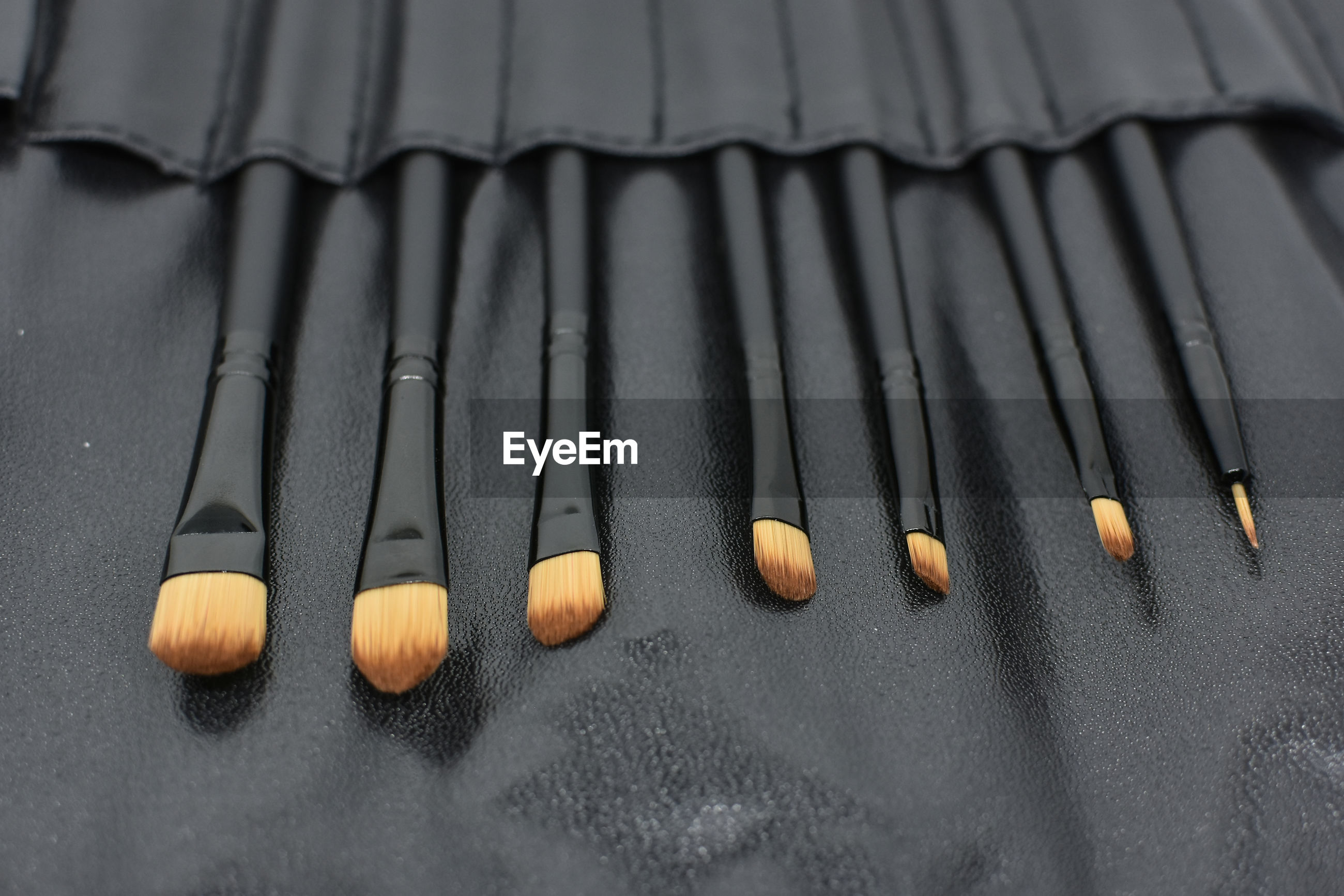 High angle view of make-up brushes