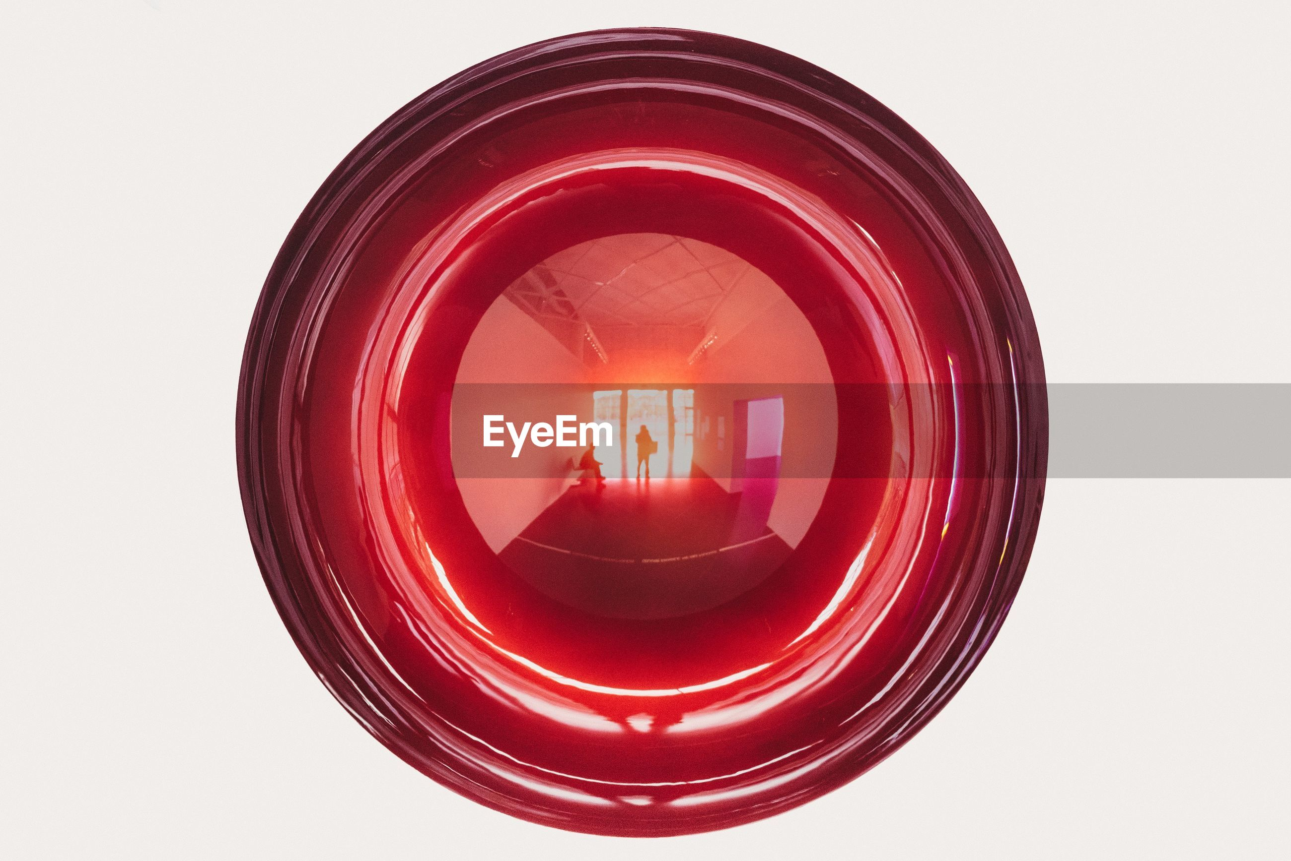 Close-up of reflection on red light over white background