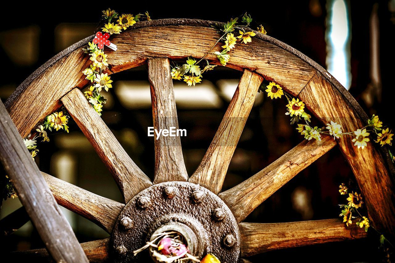 Artificial Flowers Tied On Wagon Wheel