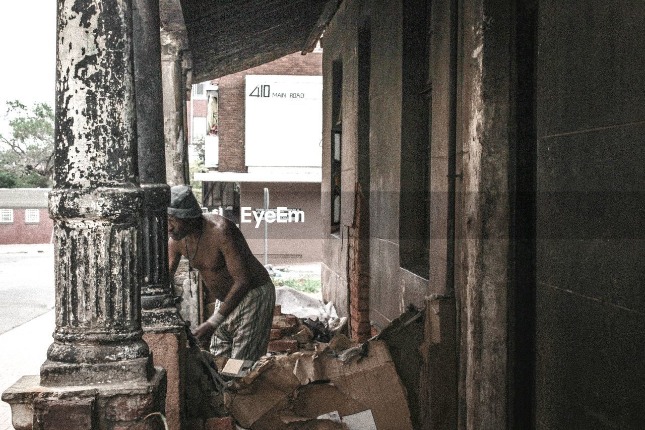 window, day, architecture, no people, abandoned, built structure, building, sitting, indoors, glass - material, transparent, damaged, mammal, open, old, obsolete, nature, pets, deterioration