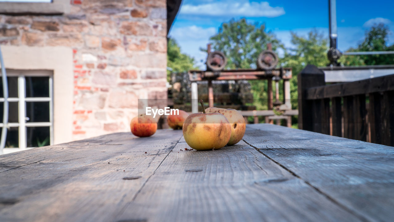 food and drink, food, wood - material, healthy eating, built structure, no people, day, nature, architecture, fruit, building exterior, focus on foreground, table, building, freshness, outdoors, wellbeing, sunlight, still life, sky