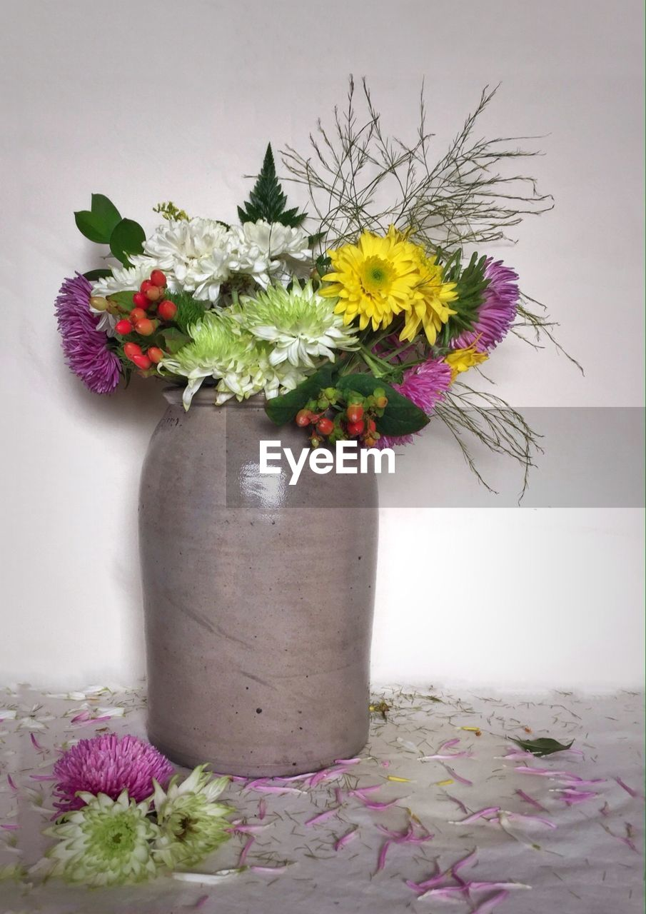flower, vase, purple, fragility, table, petal, nature, freshness, multi colored, pink color, plant, flower head, growth, beauty in nature, bouquet, no people, indoors, close-up, day