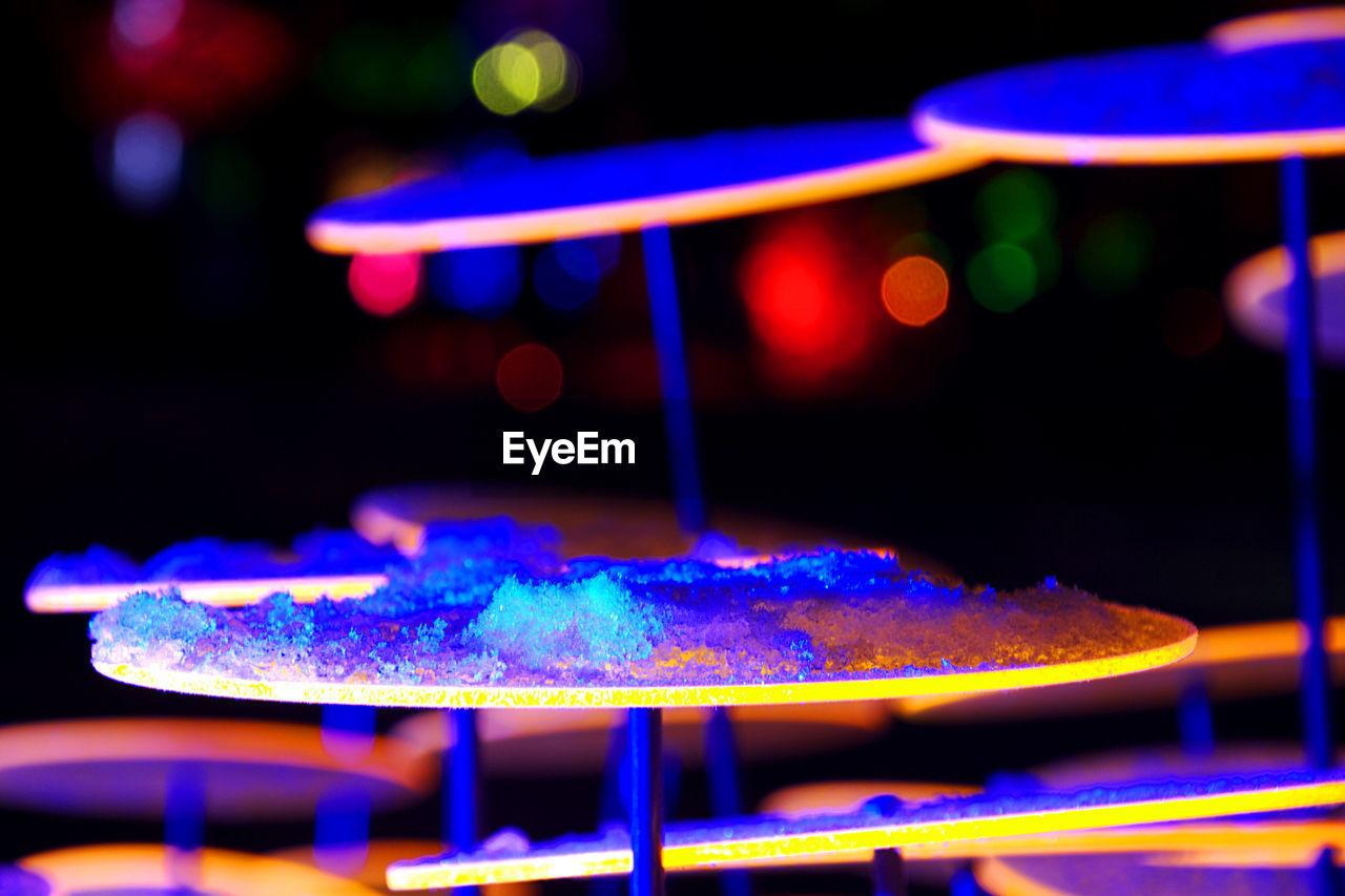Close-up of crushed ice on illuminated table