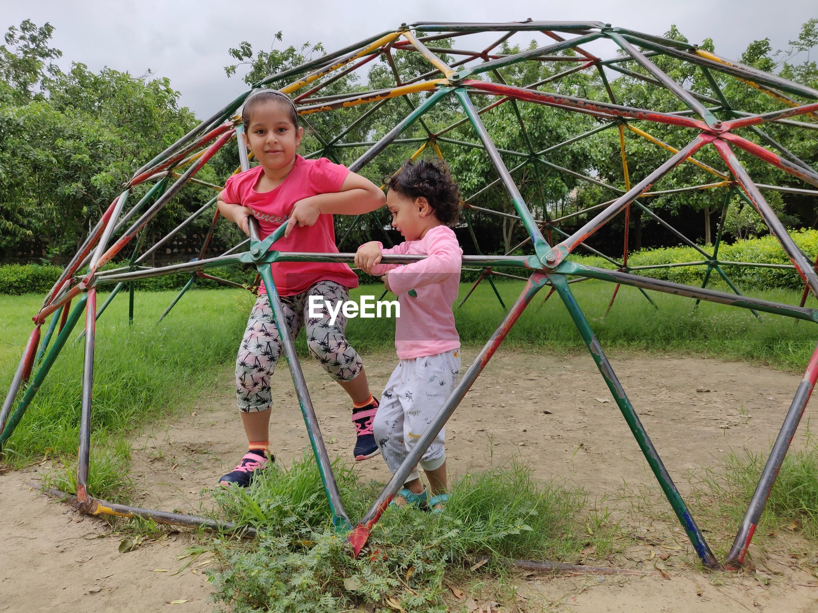 Children playing on jungle gym in playground