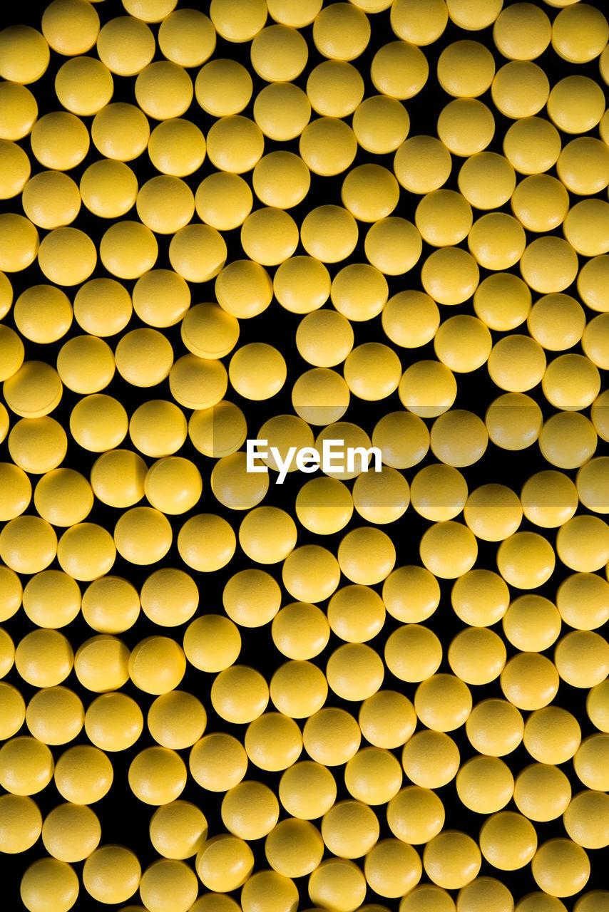 Full frame shot of yellow pills