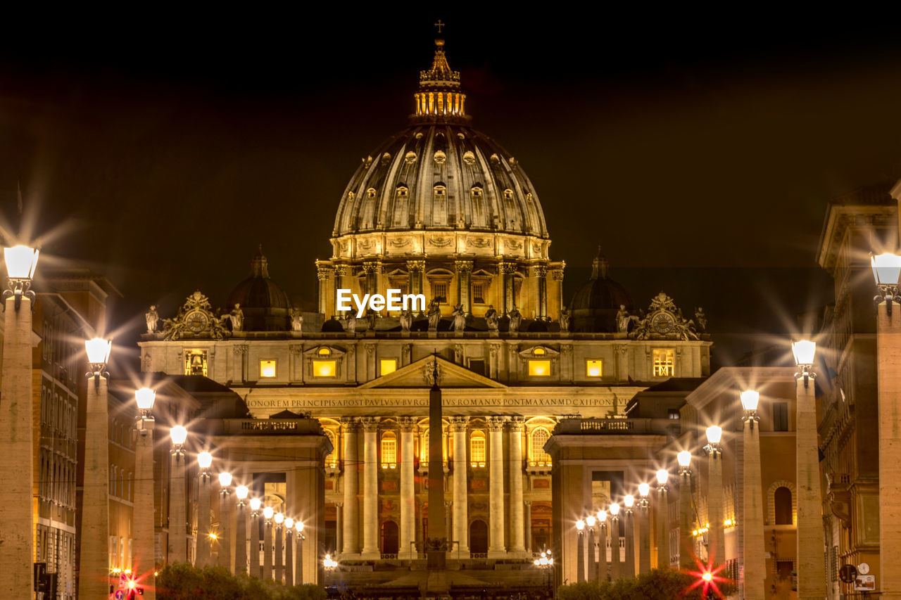 Illuminated St Peters Basilica Against Sky In City At Night