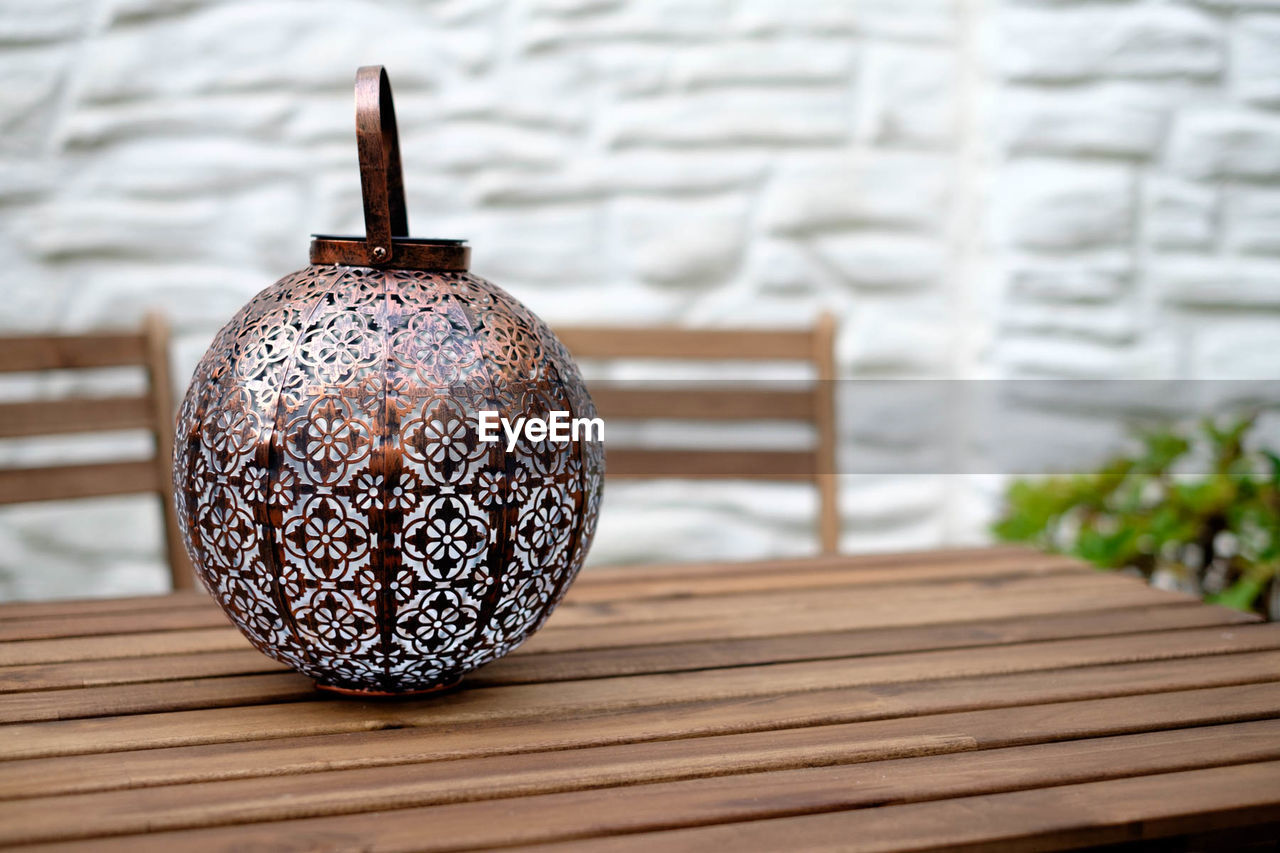 Close-up of antique container on wooden table