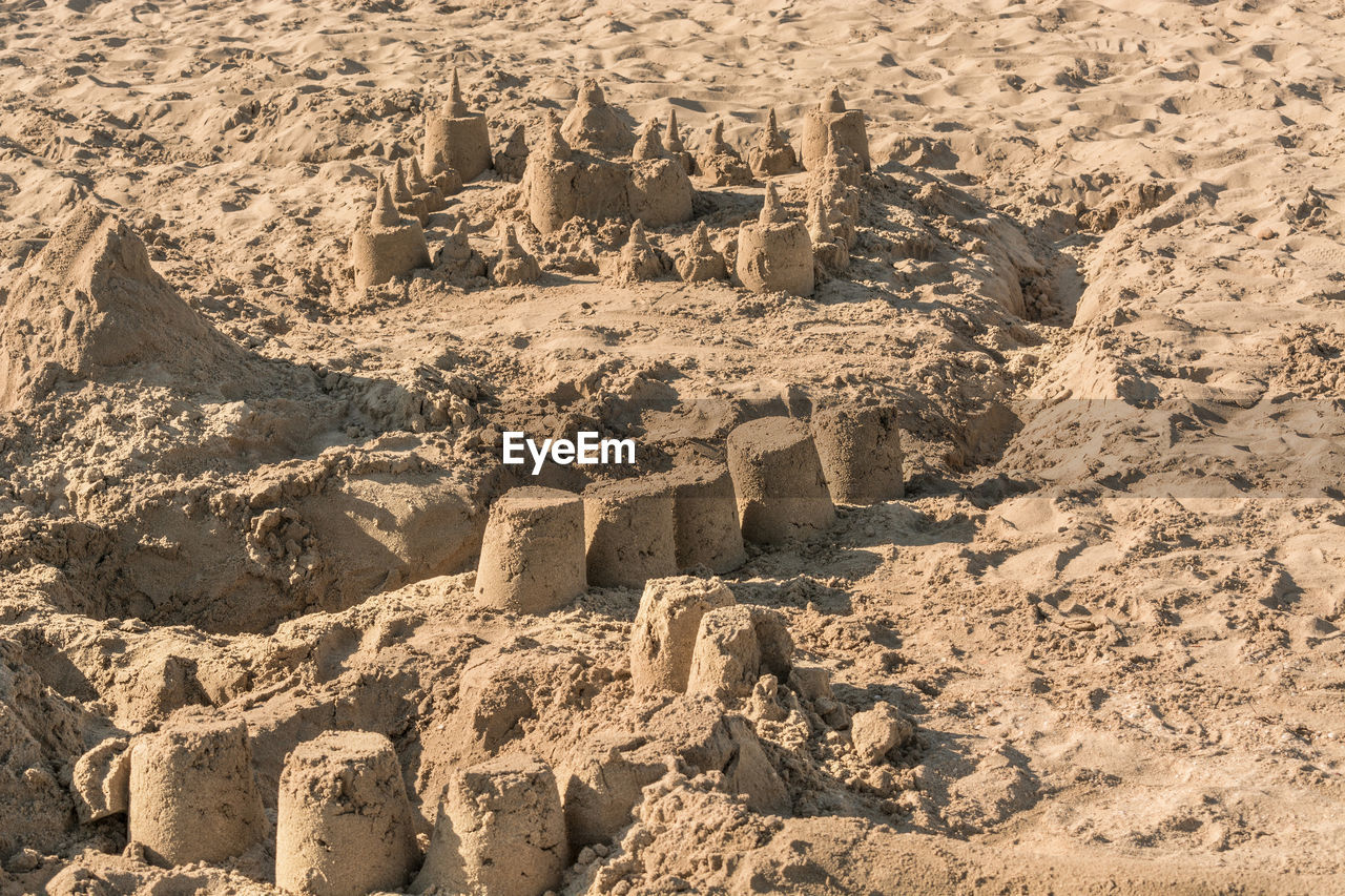 day, architecture, land, sandcastle, no people, nature, ancient, history, sunlight, sand, the past, built structure, creativity, art and craft, craft, travel destinations, ancient civilization, old ruin, outdoors, high angle view, arid climate, climate, ruined