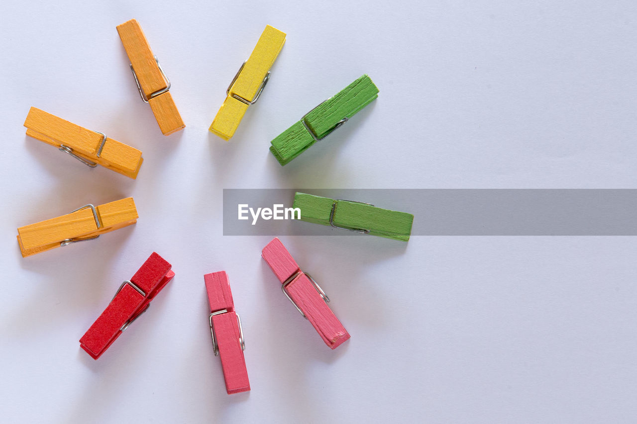 Close-up of wooden clothespins against white background
