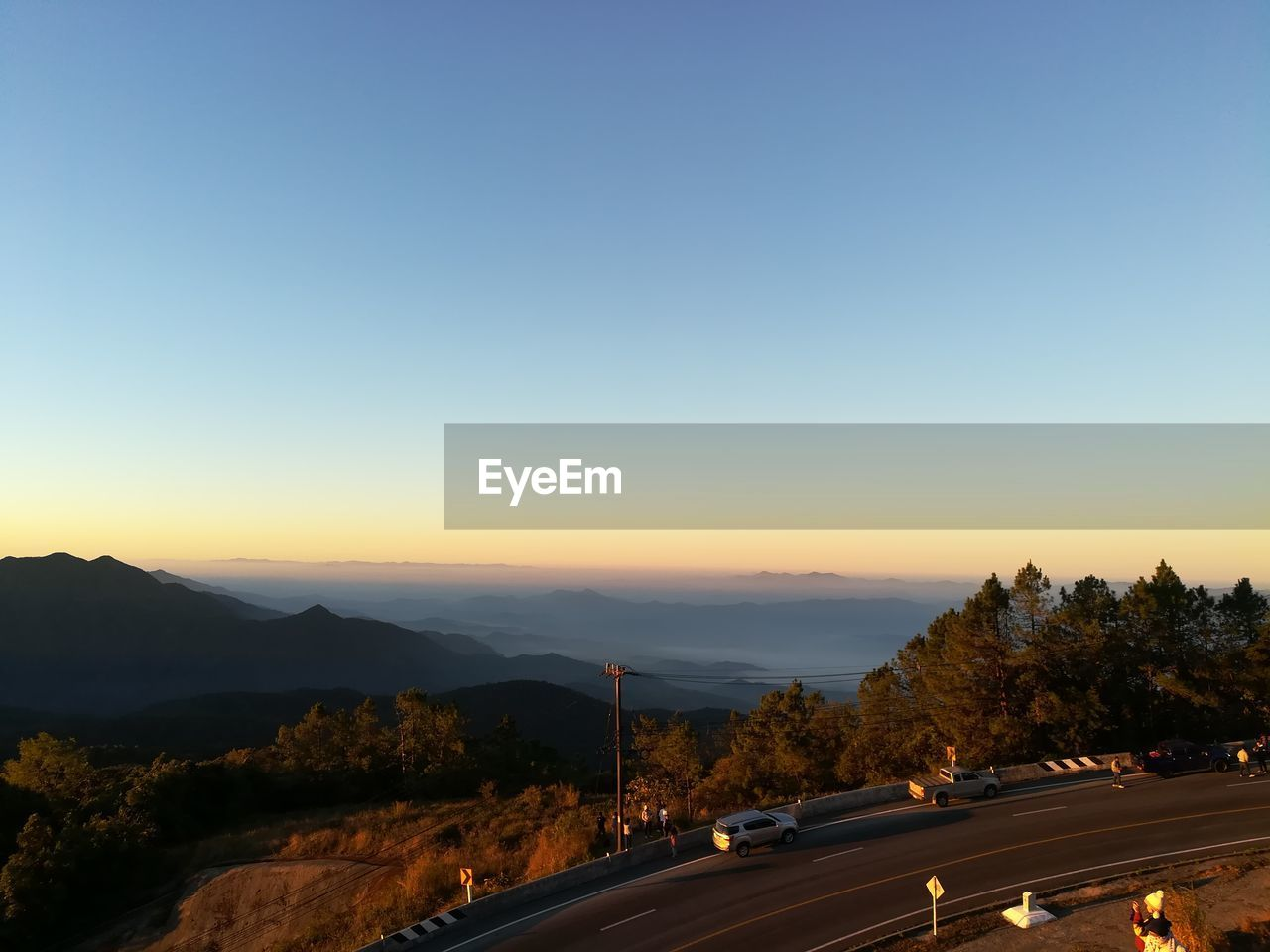 transportation, road, car, copy space, mountain, land vehicle, sunset, clear sky, tree, nature, no people, outdoors, the way forward, scenics, beauty in nature, sky, day