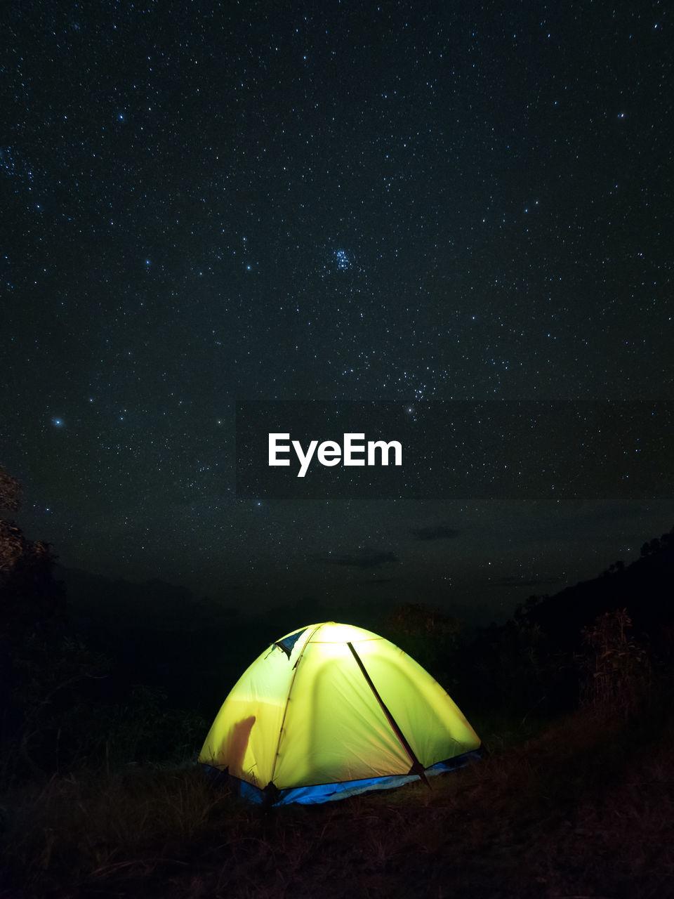Illuminated Tent Against Sky At Night