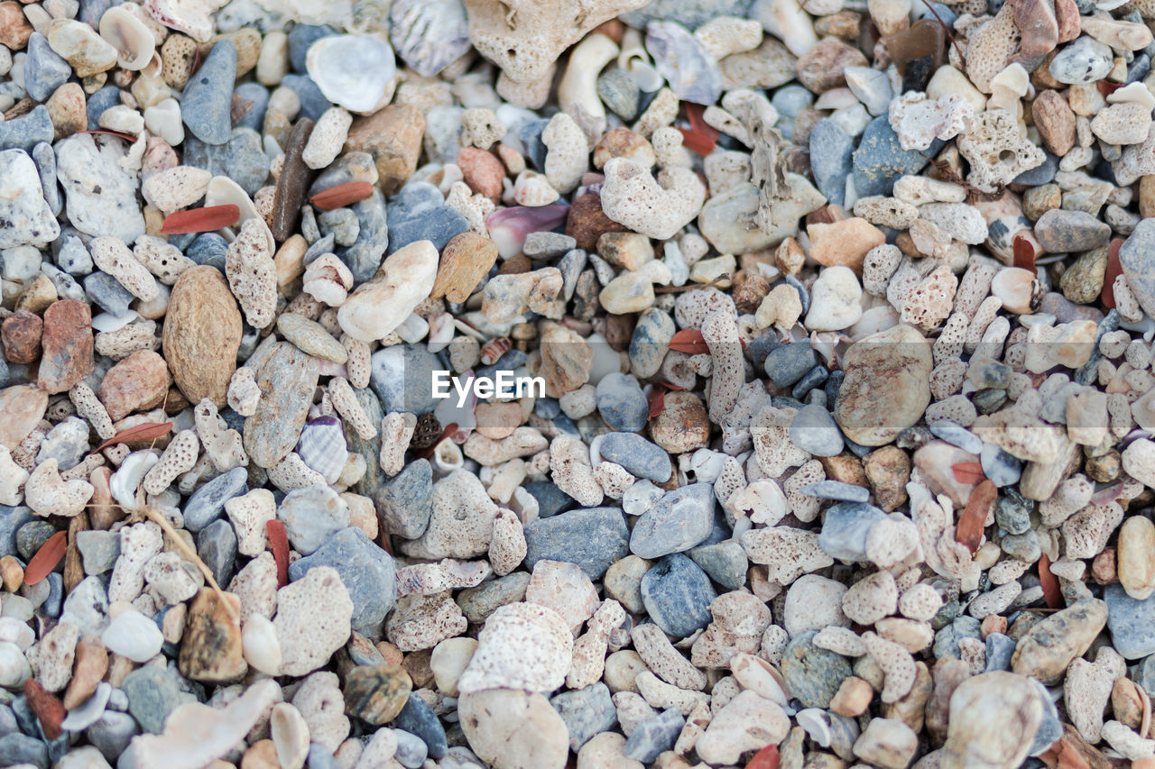 full frame, stone - object, large group of objects, backgrounds, solid, stone, abundance, pebble, rock, day, high angle view, no people, land, nature, textured, beach, directly above, close-up, outdoors, rough, gravel