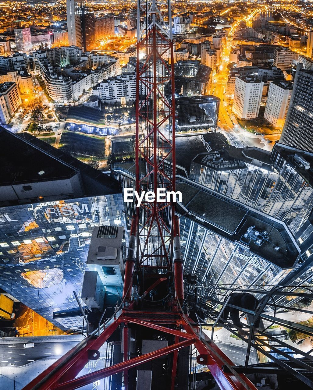architecture, building exterior, built structure, industry, high angle view, city, no people, fuel and power generation, illuminated, cityscape, transportation, connection, outdoors, metal, technology, pipe - tube, nature, building, factory, travel, skyscraper, industrial equipment