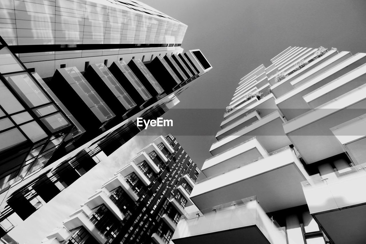 architecture, building exterior, built structure, building, low angle view, city, sky, no people, residential district, day, nature, office building exterior, tall - high, modern, skyscraper, outdoors, window, office, apartment, tower