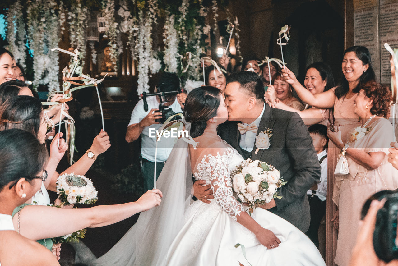 celebration, wedding, event, bride, newlywed, wedding dress, ceremony, flower, life events, togetherness, real people, married, women, adult, wedding ceremony, flowering plant, group of people, flower arrangement, love, bouquet, positive emotion, couple - relationship, wife, mature adult