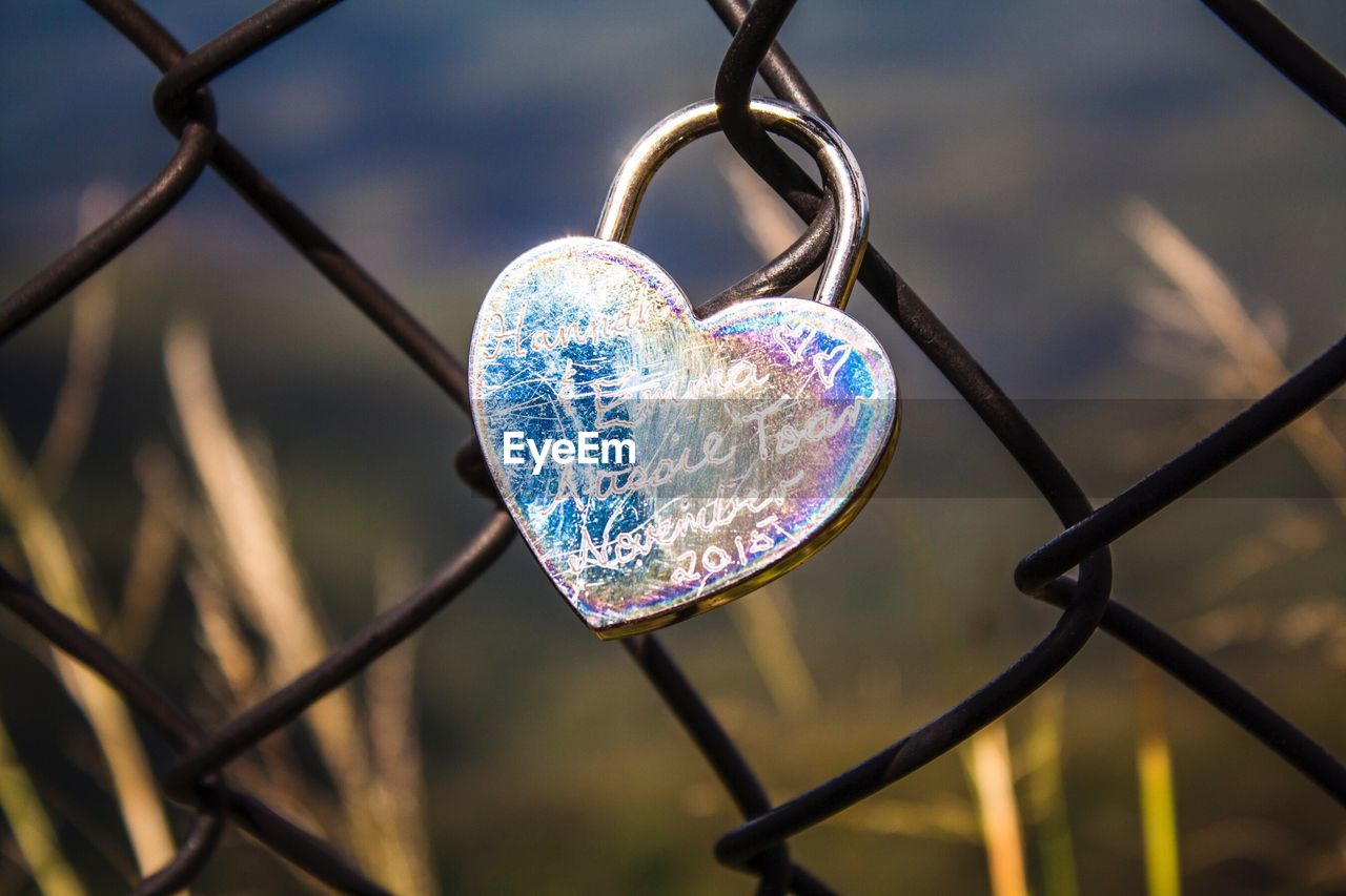 love, heart shape, positive emotion, focus on foreground, security, emotion, close-up, metal, safety, fence, no people, protection, day, barrier, nature, boundary, padlock, chainlink fence, lock, outdoors, love lock