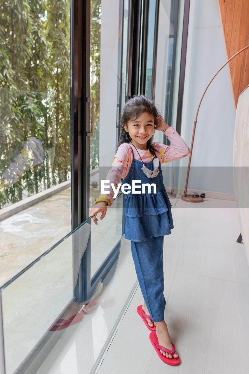 Cute little girl standing posing