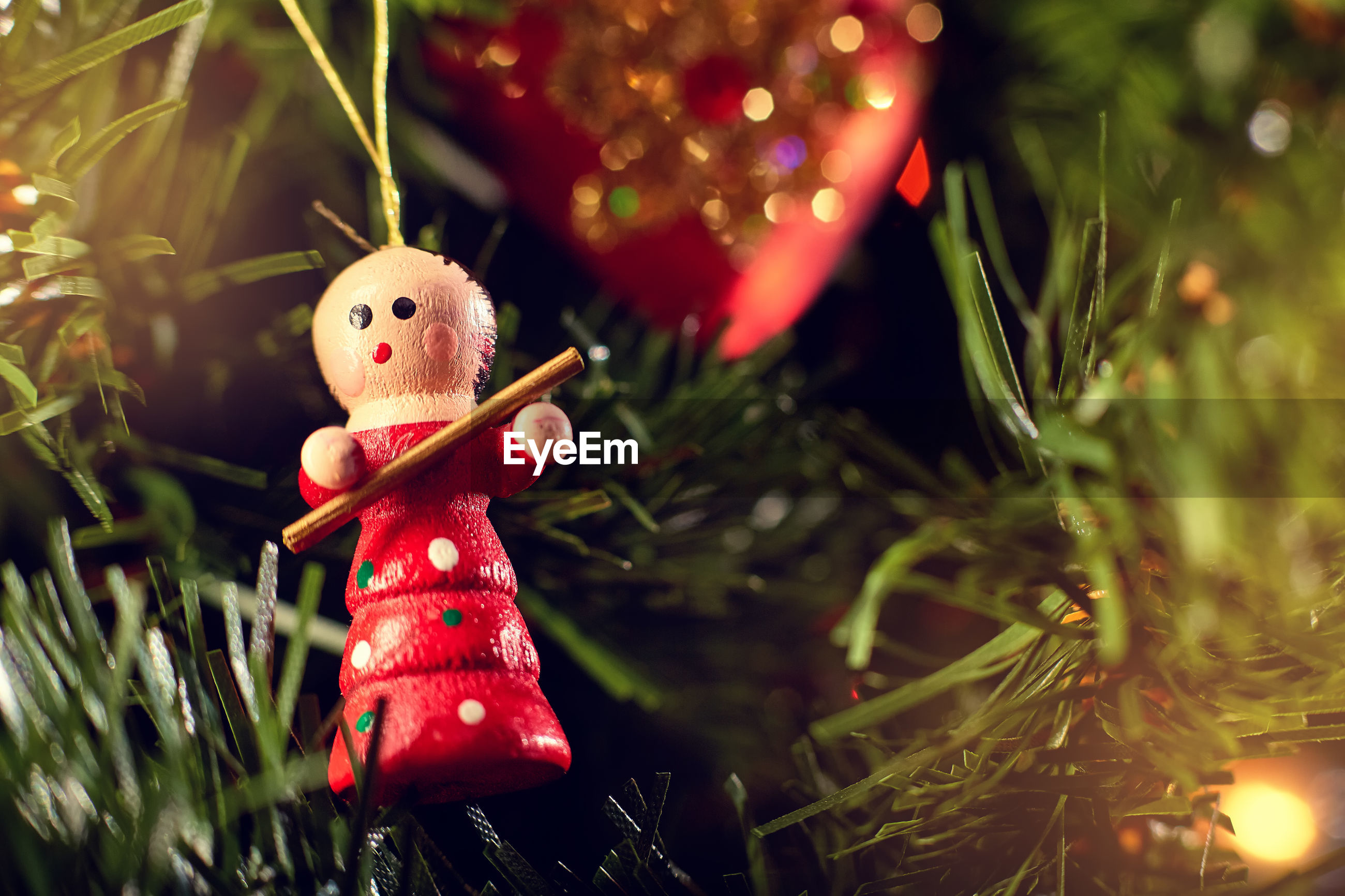 Close-up of figurine hanging on christmas tree