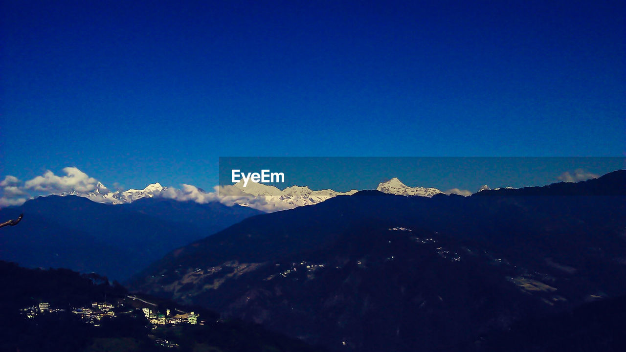 mountain, blue, mountain range, clear sky, no people, scenics, nature, outdoors, tranquility, tranquil scene, day, beauty in nature, landscape, sky