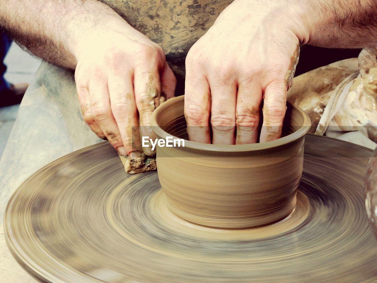 Close-Up Of Man Making A Pot