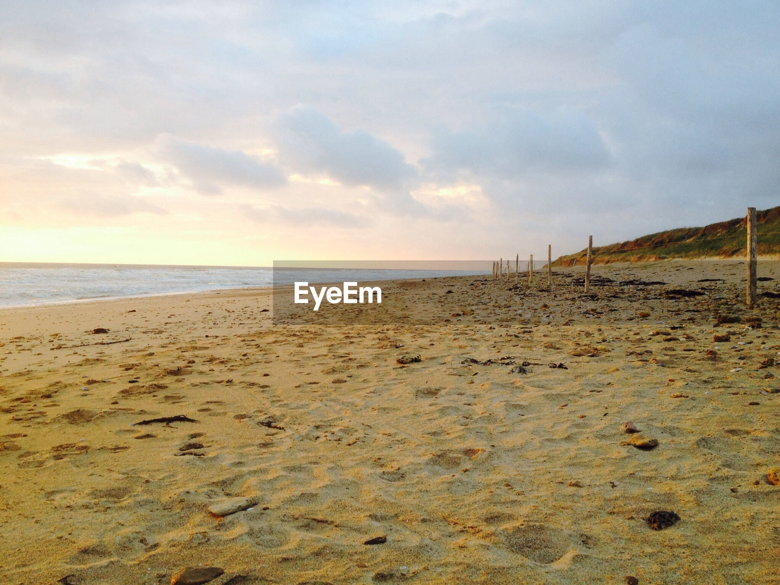 beach, sea, sky, horizon over water, water, sand, shore, tranquil scene, tranquility, scenics, cloud - sky, beauty in nature, nature, cloud, cloudy, coastline, idyllic, calm, outdoors, remote