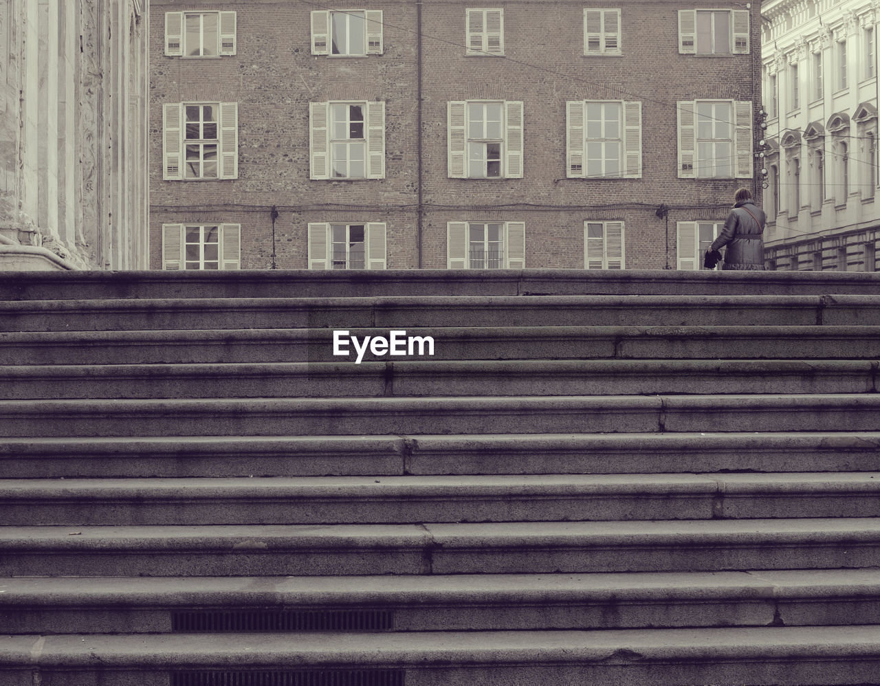 architecture, built structure, staircase, building exterior, real people, window, one person, steps and staircases, men, low angle view, day, lifestyles, full length, walking, building, city, outdoors, pattern, moving up