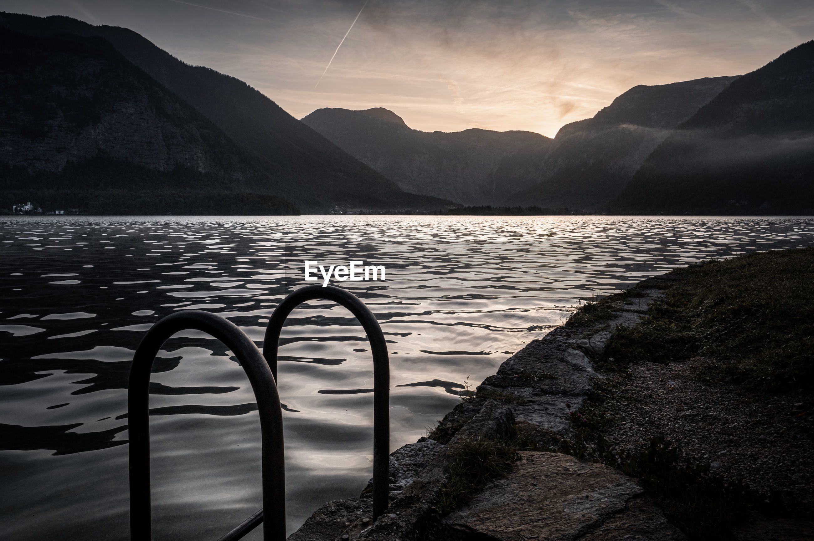 SCENIC VIEW OF LAKE AGAINST MOUNTAIN DURING SUNSET