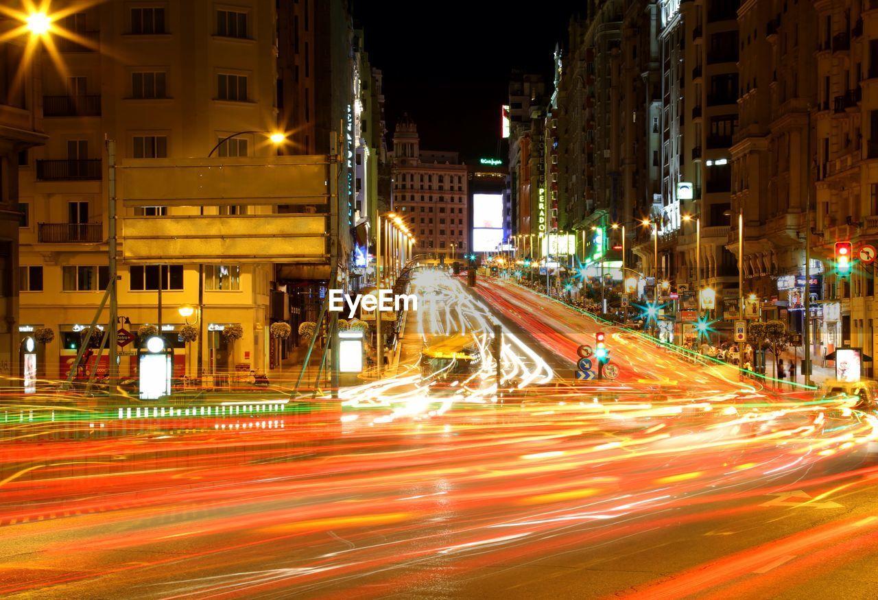 Illuminated light trail on city street at night