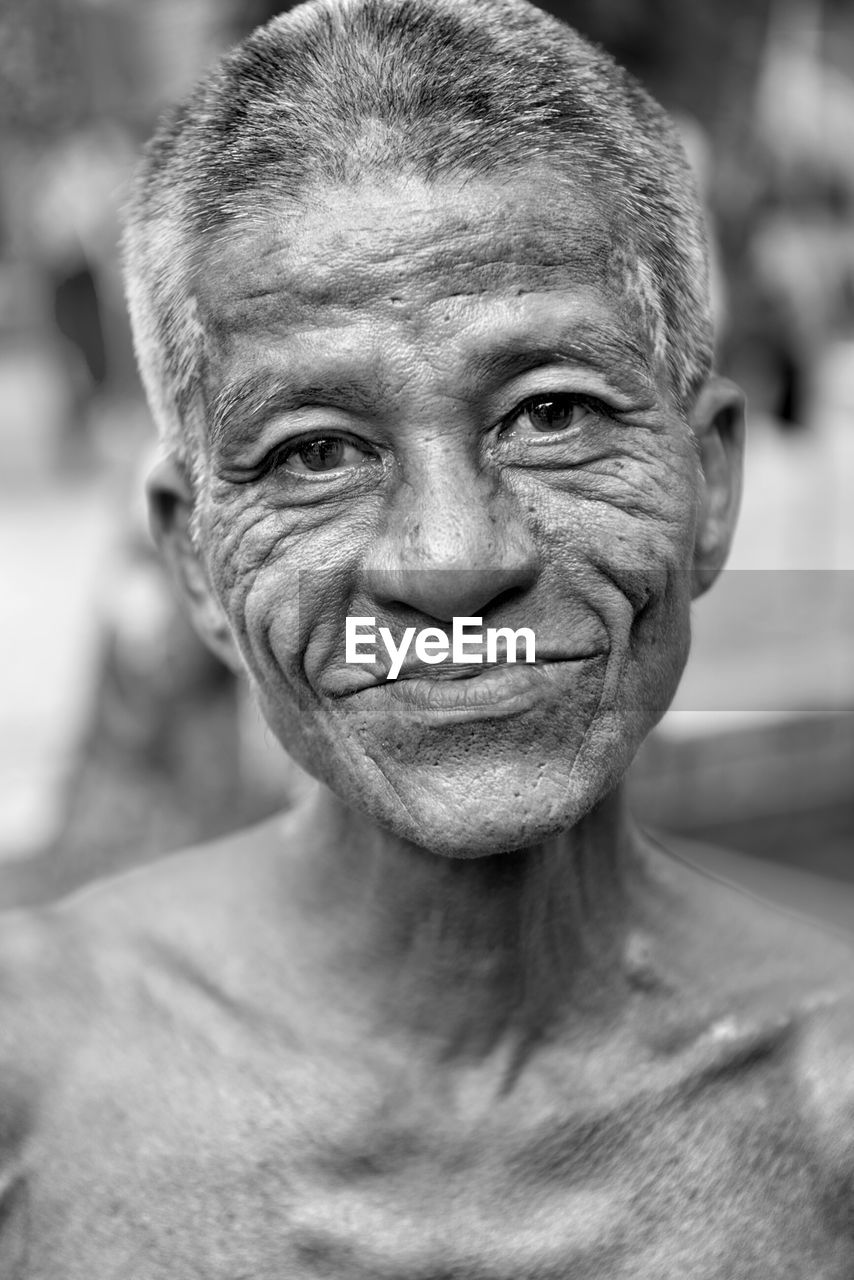 portrait, looking at camera, headshot, real people, one person, focus on foreground, smiling, close-up, adult, front view, senior adult, lifestyles, shirtless, mature adult, wrinkled, leisure activity, human body part, males, happiness, mature men, human face