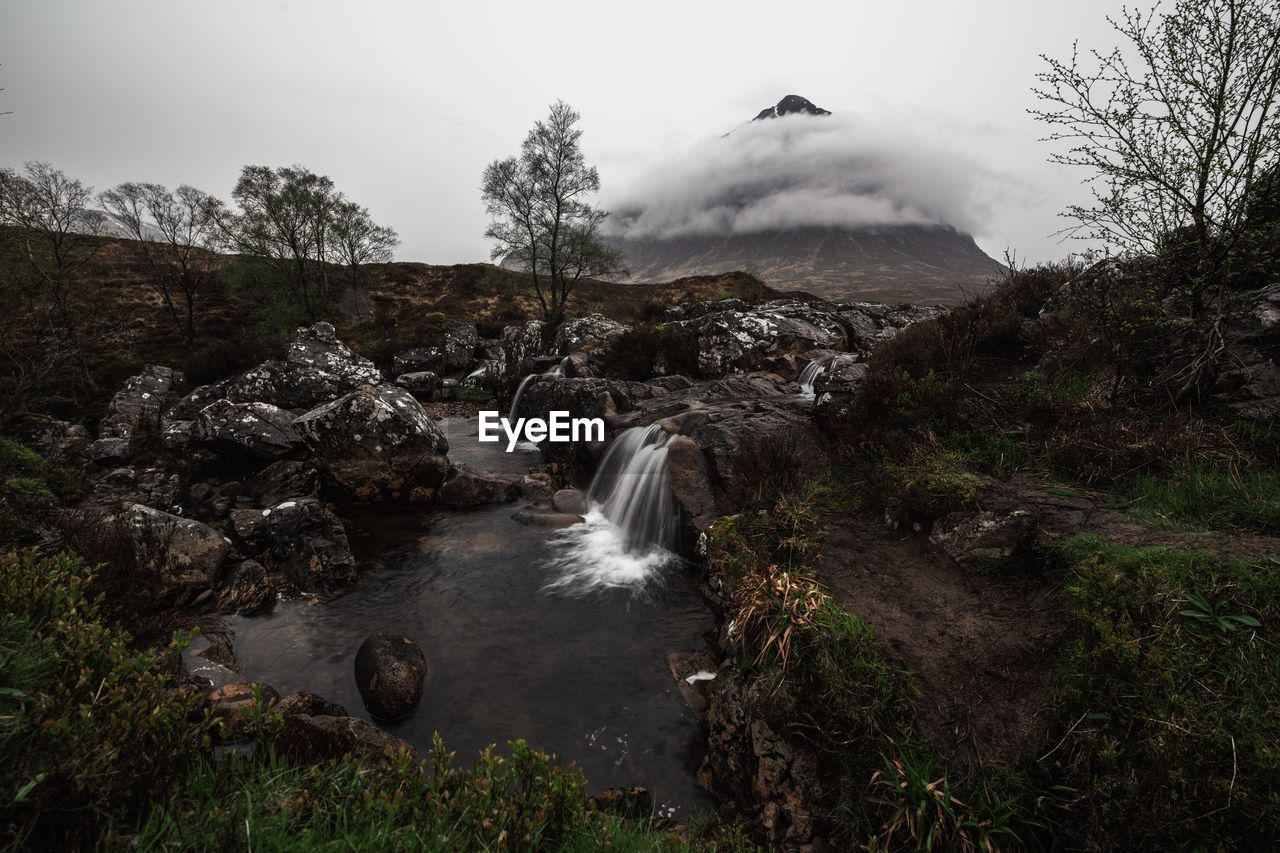 water, scenics - nature, beauty in nature, motion, tree, mountain, sky, nature, waterfall, no people, long exposure, rock, plant, environment, flowing water, rock - object, land, non-urban scene, blurred motion, outdoors, power in nature, flowing